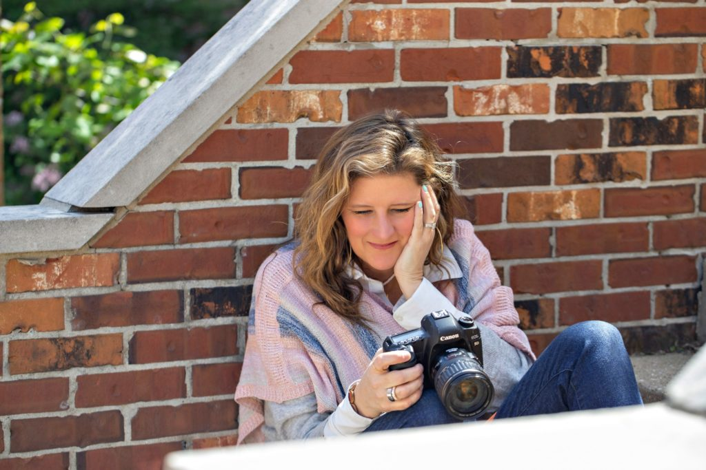 Sarah Petty Photography holding canon camera how to not feel like an imposter in your photography business blog